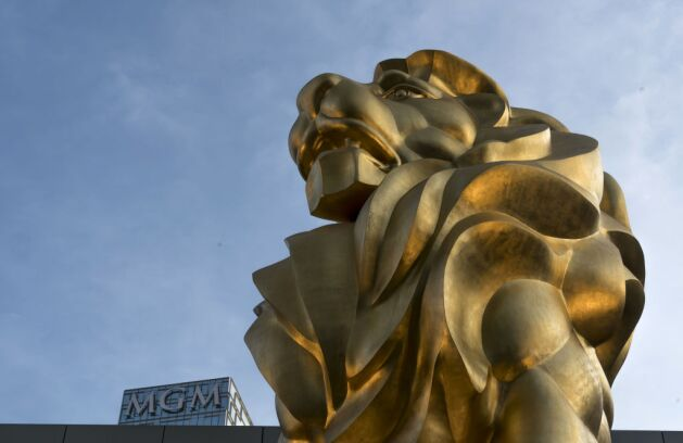 A lion statue stands outside an MGM casino.