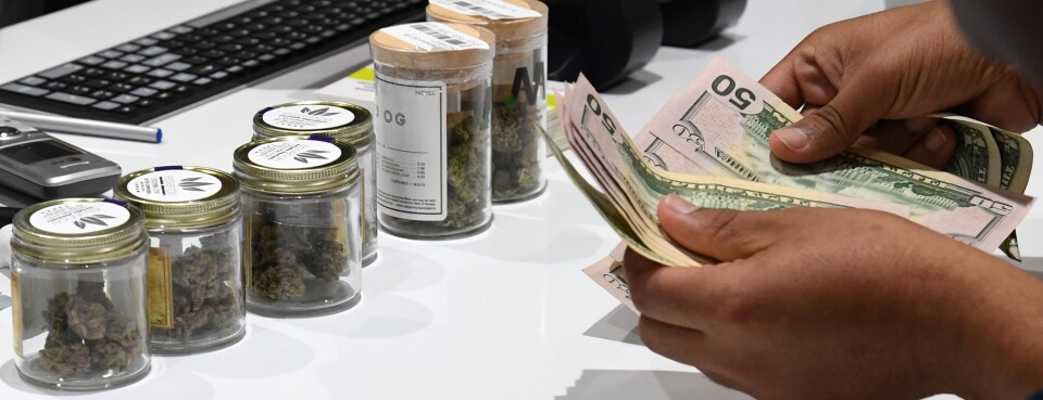Cannabis / Marijuana  - Insights: A customer pays for cannabis products at Essence Vegas Cannabis Dispensary after the start of recreational marijuana sales began on July 1, 2017, in Las Vegas