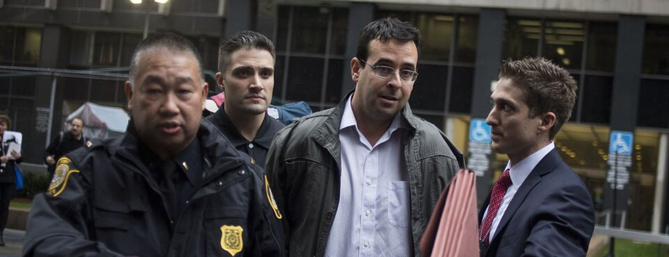 Photo of attorney Evan Greebel exiting federal court in New York after his 2015 arrest.