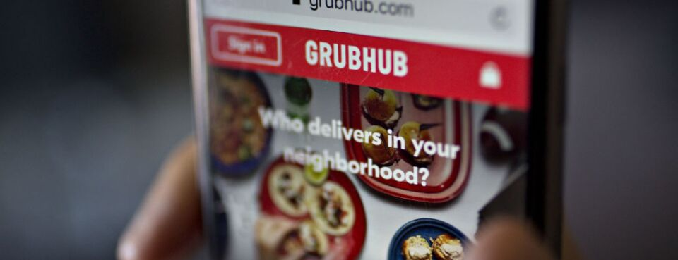 The GrubHub Inc. website is demonstrated on a smartphone.