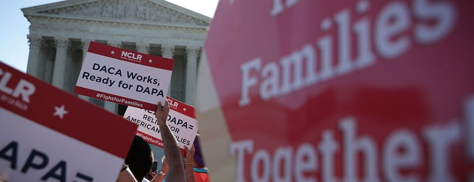Pro-immigration activists gather in front of the U.S. Supreme Court on April 18, 2016 in Washington.