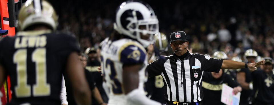 263165c1c A referee watches as Tommylee Lewis  11 of the New Orleans Saints drops a  pass broken up by Nickell Robey-Coleman  23 of the Los Angeles Rams during  the ...