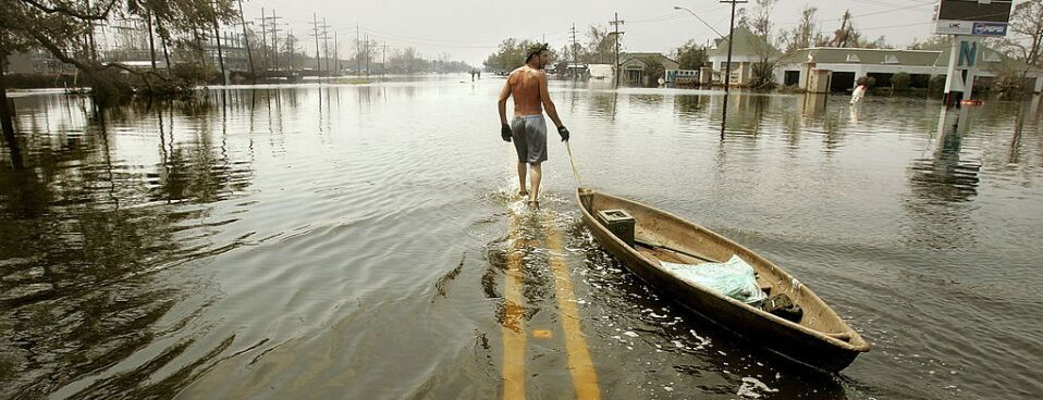 A man pulls a canoe down a flooded street in the hard-hit Chalmette community of Saint Bernard's Parish September 3, 2005 in New Orleans., five days after Hurricane Katrina first made landfall on the U.S. Gulf Coast.