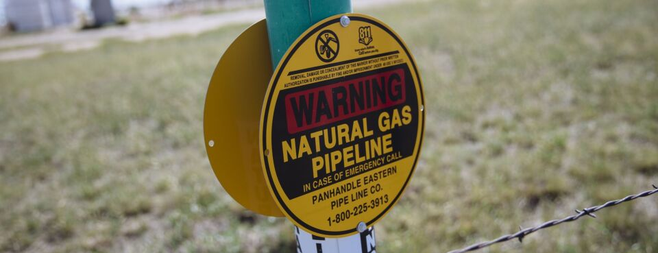 Natural gas pipeline - Insights: A warning sign for an underground natural gas pipeline stands near Sunray, Texas, on Sept. 26, 2020.