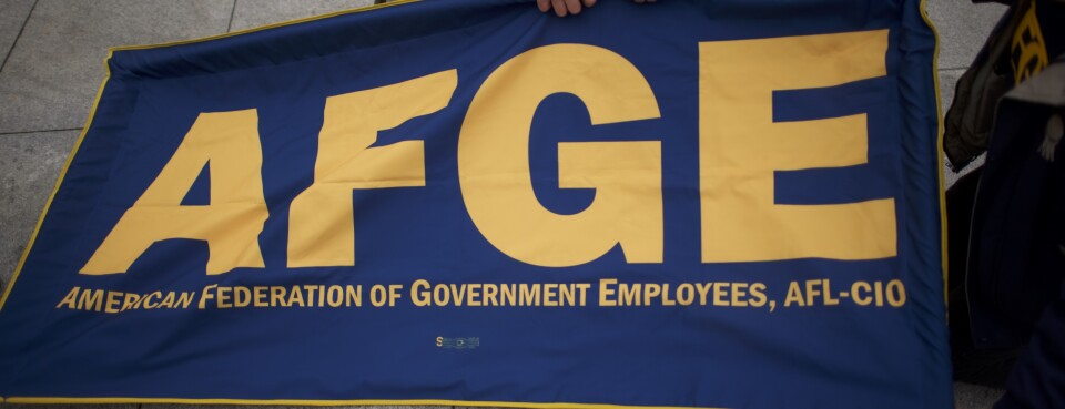 Members of the AFGE (American Federation of Government Employees) set up a banner.