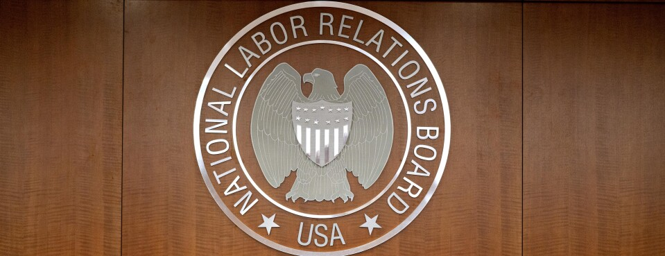 The National Labor Relations Board seal hangs inside a hearing room at the headquarters in Washington, on Sept. 30.