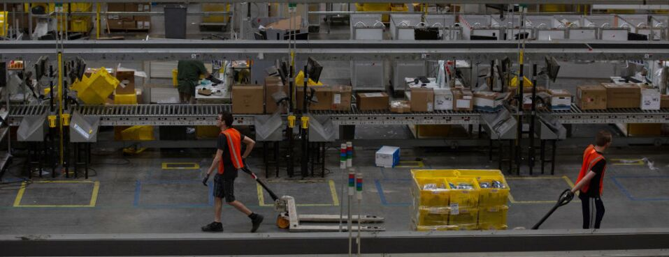 Employees pull carts at the Amazon.com Inc. fulfillment center in Robbinsville, N.J. Some 54 workers were hospitalized Dec. 5, 2018, after an equipment puncture released a bear spray chemical.