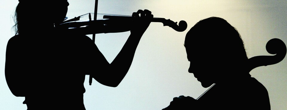 violin players in silhouette (used 7/5/18)