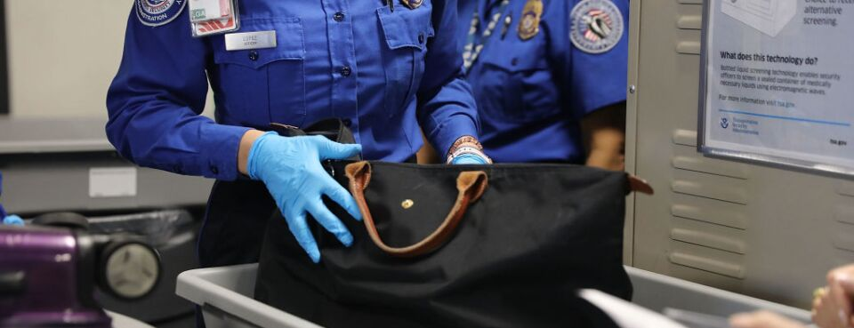 TSA worker checking bag (used 9/10/18)