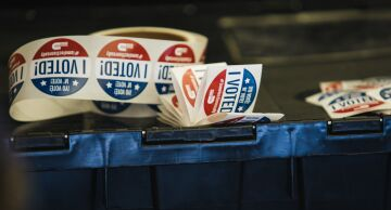 """Photos of stickers that read """"I Voted."""""""