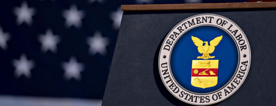 The U.S. Department of Labor seal hangs on a podium outside the headquarters in Washington, Aug. 29.