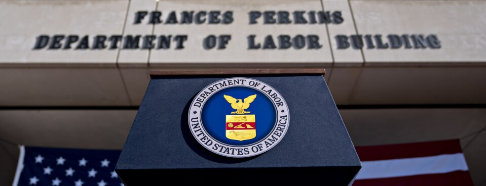 The U.S. Department of Labor seal hangs on a podium outside the headquarters in Washington, D.C., on Aug. 29, 2019.