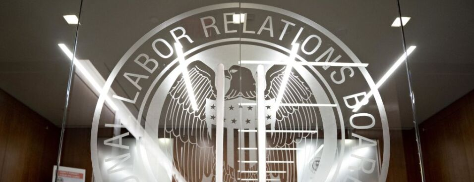 The National Labor Relations Board seal is displayed on a door at the headquarters in Washington, on Monday, Sept. 30.