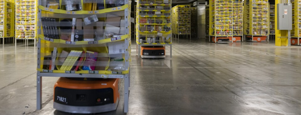 Kiva Systems Inc. robots move shelves at the Amazon.com Inc. fulfillment center in Baltimore, Maryland, U.S., on Tuesday, April 30, 2019.