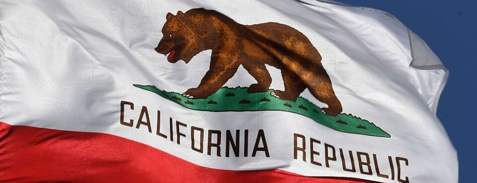 The California State flag flies outside City Hall, in Los Angeles, California on January 27, 2017.