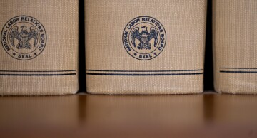 The National Labor Relations Board seal is displayed on decisions and orders volumes at the headquarters in Washington, on Monday, Sept. 30, 2019.
