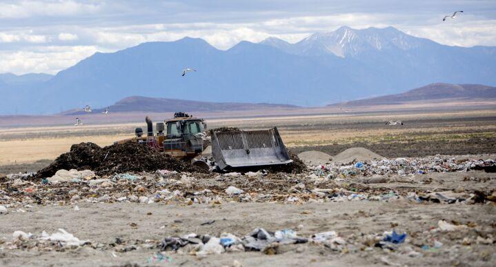 Photo of a bulldozer moving trash at a landfill in Utah.