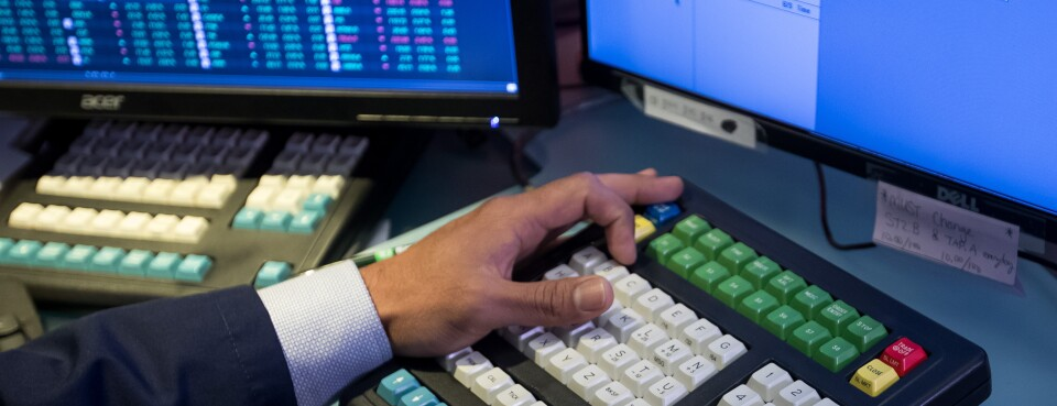 NYSE trader during IPO - Insights: A trader works during Slack Technologie's initial public offering on the floor of the New York Stock Exchange on June 20, 2019.