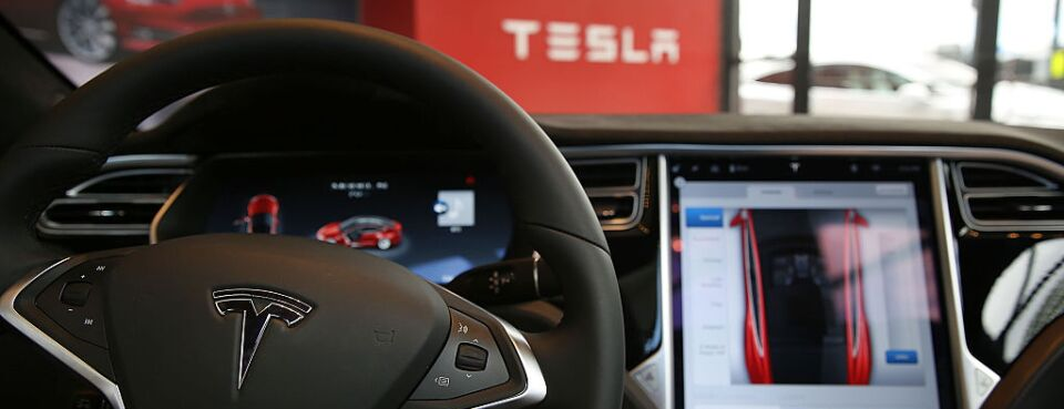 The inside of a Tesla vehicle is viewed as it sits parked in a new Tesla showroom.