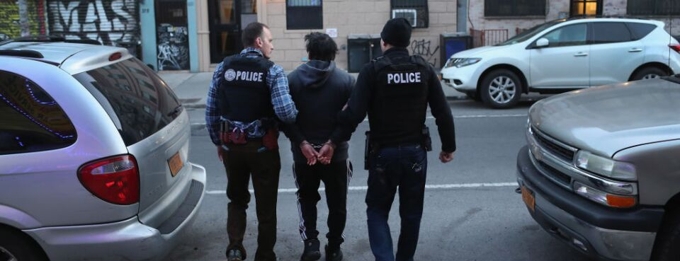 ICE officers arrest an undocumented Mexican immigrant during a raid in the Bushwick neighborhood of Brooklyn on April 11, 2018 in New York City.