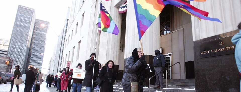 Gay marriage supporters protest next to pro-traditional marriage supporters in front of the U.S. Federal Courthouse March 3, 2014 in Detroit, Mich. The state's civil rights agency said Feb. 1, 2019, that it plans to implement a discrimination tracker database of bias claims in workplaces and public facilities throughout the state.