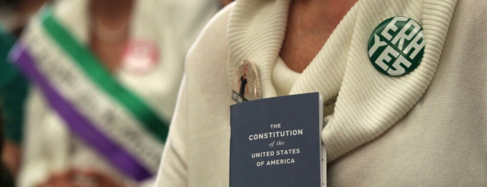 An activist holds a copy of the U.S. Constitution during an April 30, 2019 Capitol Hill news conference where Democratic lawmakers called for ratification of the Equal Rights Amendment.