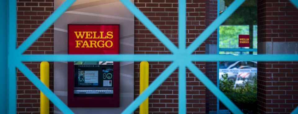 An Automatic Teller Machine ATM Is Seen Behind A Fence At Wells Fargo Co Bank Branch In Schaumburg Illinois US On Tuesday July 10 2018