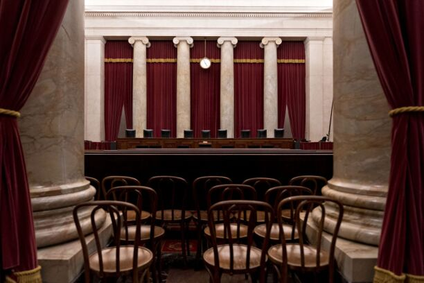 Chairs of U.S. Supreme Court justices sit behind the courtroom bench in Washington, D.C.