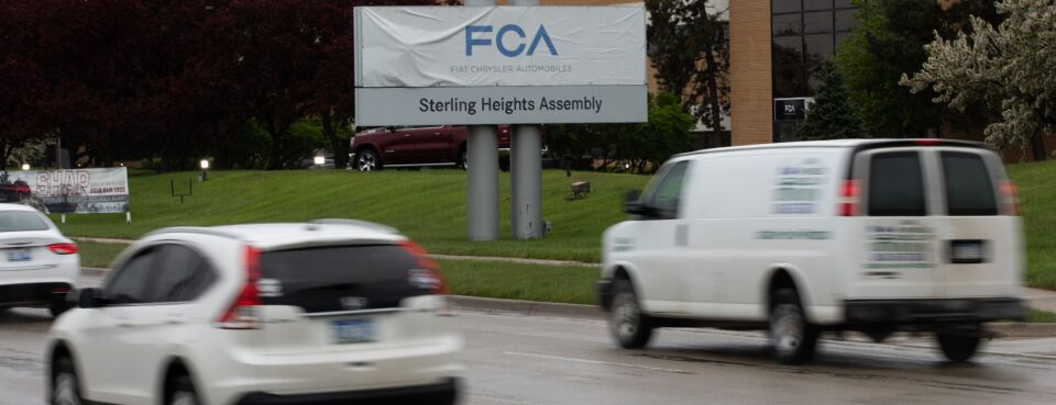Photo of traffic passing a Fiat Chrysler assembly plant in Sterling Heights, Mich.