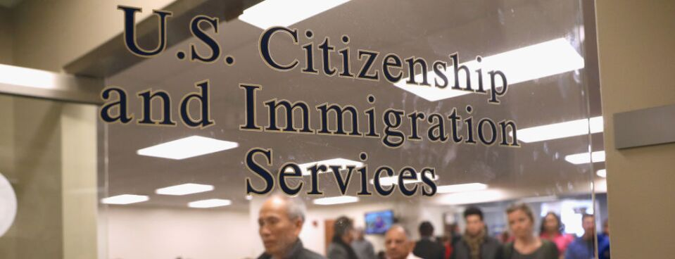 Immigrants at a U.S. Citizenship and Immigration Services office in New Jersey. A new lawsuit alleges the agency illegally denied an immigrant an extension of his H-1B temporary work visa some 18 months before receiving permanent residency.