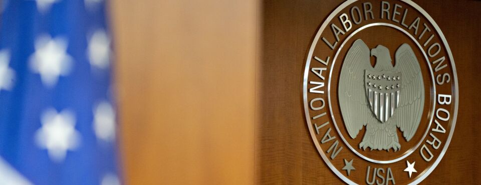 The National Labor Relations Board (NLRB) seal hangs inside a hearing room at the headquarters in Washington, on Sept. 30, 2019.