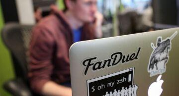 Photo of FanDuel logo stuck to a laptop.