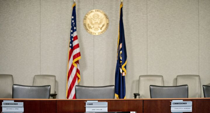 Chairs sit inside the Equal Employment Opportunity Commission hearing room at the headquarters in Washington, on Feb. 18, 2020.