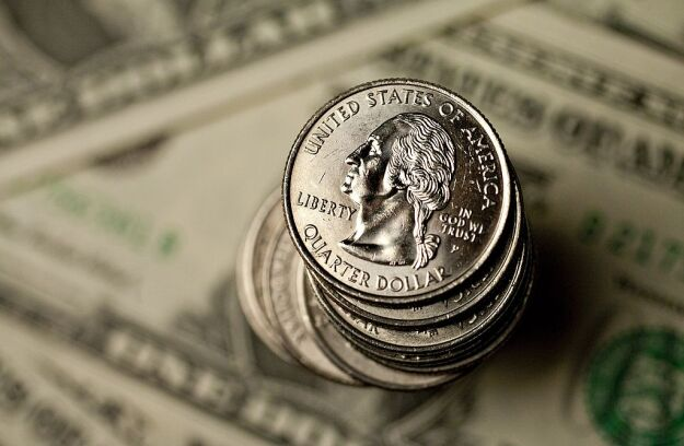 U.S. quarters and dollar bills.