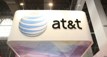 Photo of the AT&T logo displayed at a trade show.