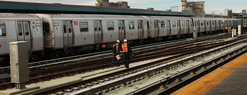 New York City Metropolitan Transportation Authority workers walk the tracks.