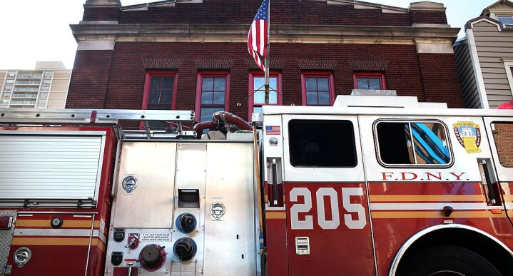 Fire truck sits outside of a Brooklyn fire house.