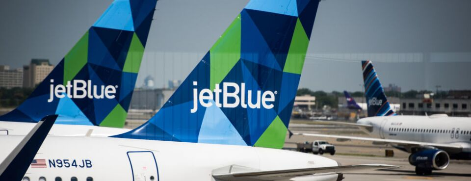 A JetBlue Airways Corp. plane sits at a gate at John F. Kennedy International Airport in New York.