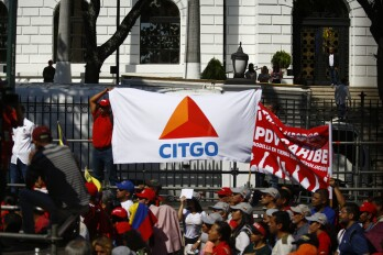 Pro- Government Supporters Hold Rally As Threats to President Maduro Keep Intensifying A pro-government supporter holds a banner displaying the logo of Citgo Petroleum, the U.S. refiner controlled by Petroleos de Venezuela SA (PDVSA), during a rally in Caracas, Venezuela, on Thursday, Jan. 31, 2019. The U.S. and more than a dozen other nations have recognized National Assembly President Juan Guaido as Venezuela's legitimate leader and are pressuring President Nicolas Maduro to step down, accusing him of rigging his re-election last year and leading the once-rich country into ruinous poverty.