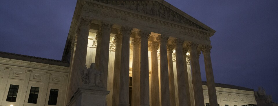 The U.S. Supreme Court building stands at dawn in Washington, on Saturday, Nov. 30.