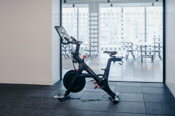 A Peloton Cycle Inc. bicycle stands in the gym area of the Dwight Capital LLC new office space inside 787 11th Avenue in New York, U.S., on Monday, July 30, 2018. The glitzy new offices at 787 11th Avenue in Hell's Kitchen for financial companies are a departure from the building's 1920s roots as a service hub for Packard Motor Car Co.