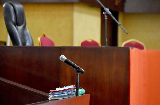 A picture taken on October 25, 2016 shows an empty dock at the courtroom of Abidjan as the lawyers of Ivory Coast's former first lady Simone Gbagbo suspended their participation in her trial for crimes against humanity because the court refused to hear testimony from leading politicians.