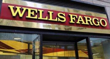 Photo of a Wells Fargo & Co. sign outside a bank branch in New York.
