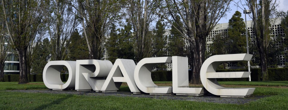 Signage stands at the Oracle Corp. headquarters campus in Redwood City, Calif.  The computer technology company was accused of hiring and pay discrimination involving workers with visas.