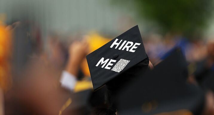 A graduating student's cap declares their future intentions.  A new Trump administration policy could make it more difficult for foreign grads to get an H-1B visa.