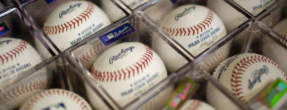 Photo of Rawlings Sporting Goods Co. Inc. baseballs displayed for sale at a Modell's retail location in Times Square in New York.