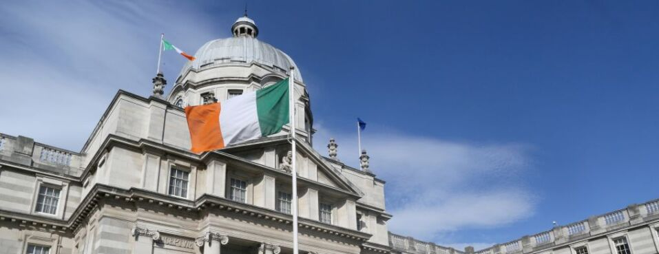 An Irish national flag flies outside the Government Buildings in Dublin, Ireland.