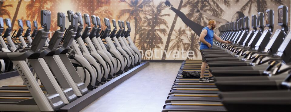 Photo of a person standing on a treadmill at a gym in Toronto, Ontario, Canada.
