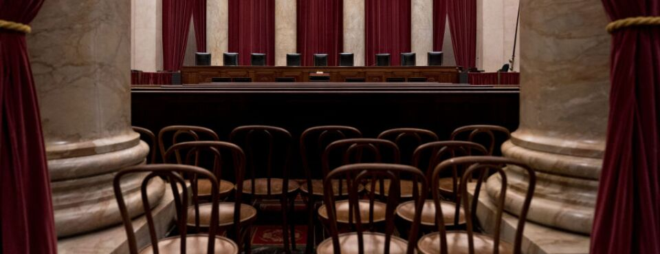Chairs of U.S. Supreme Court justices sit behind the courtroom bench in Washington.