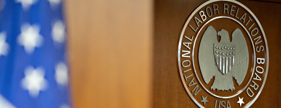 The National Labor Relations Board seal hangs inside a hearing room at the headquarters in Washington on Sept. 30, 2019.